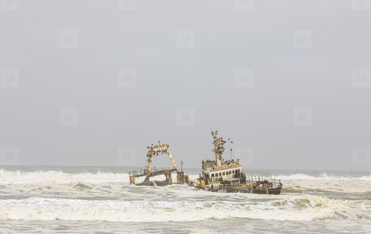 Shipwreck in ocean surf Torra Bay  Namibia