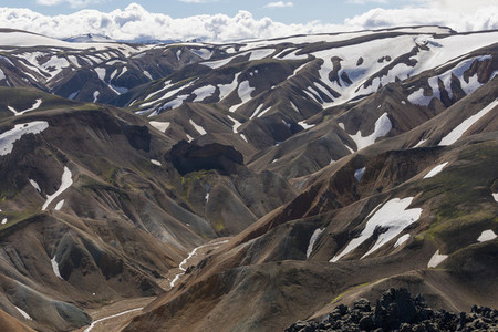 Snow patches on scenic mountain landscape Iceland