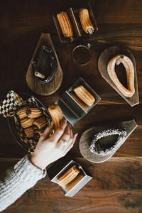 Woman eating assortment of churros