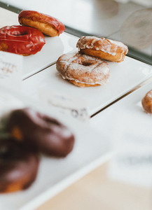 Close up donuts on display in bakery
