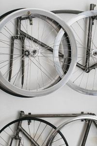 Bicycle rims and frames hanging on wall