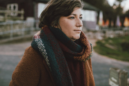 Young woman wearing autumn scarf