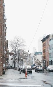 Snow falling over urban street Brooklyn New York USA