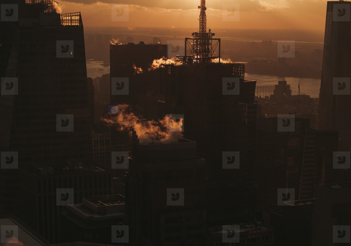 Silhouetted buildings at sunset New York  USA