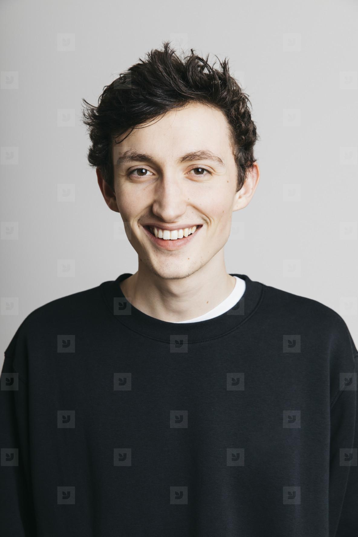 Portrait smiling young brunette man