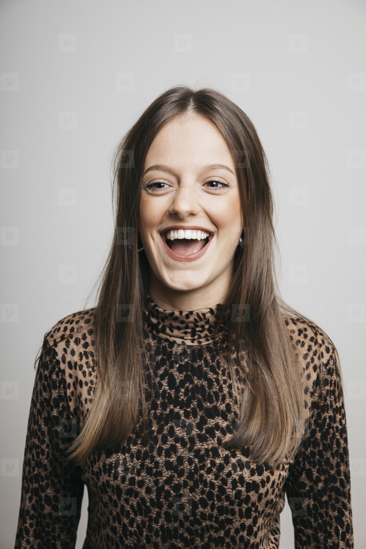 Portrait happy young brunette woman