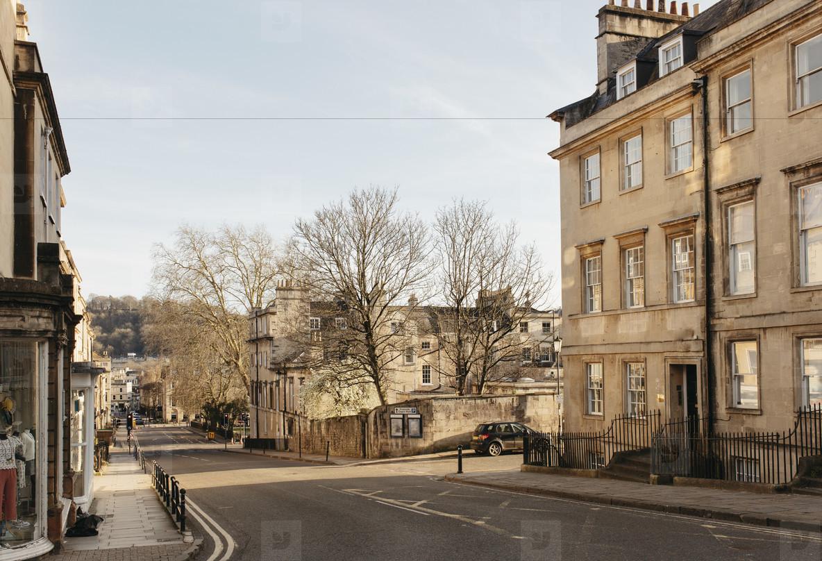 Sunny buildings and empty street Bath Somerset  UK