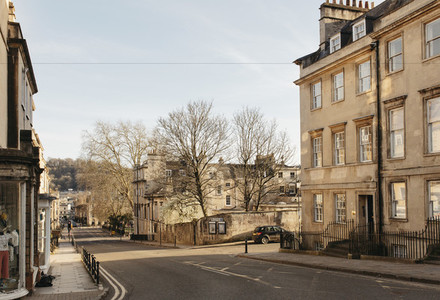 Sunny buildings and empty street Bath Somerset UK