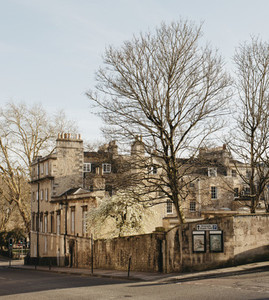Sunny buildings and bare trees Bath Somerset UK