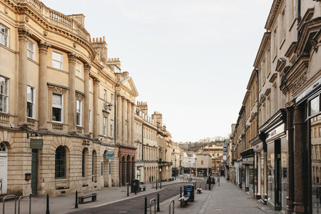 Buildings along empty street Bath Somerset UK