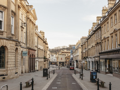 Buildings along empty main street Bath Somerset UK