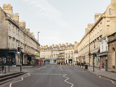 Buildings along empty main street Bath Somerset UK