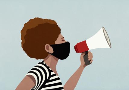 Black woman in face mask using megaphone