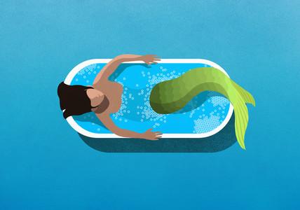 Mermaid bathing in soaking tub