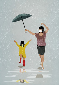 Mother and daughter in face masks running playfully in rain
