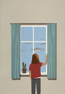 Woman looking at swimming fish from window