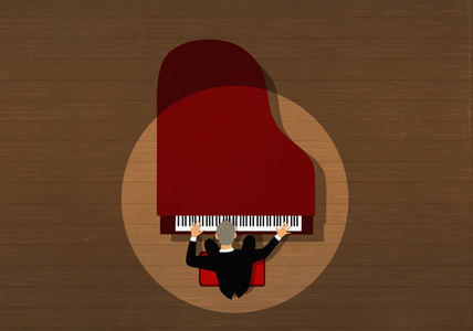 Concert pianist performing at grand piano on stage under spotlight