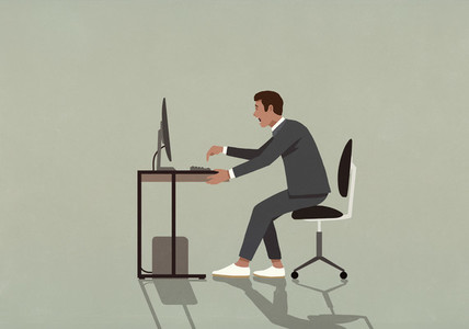 Excited businessman working at computer