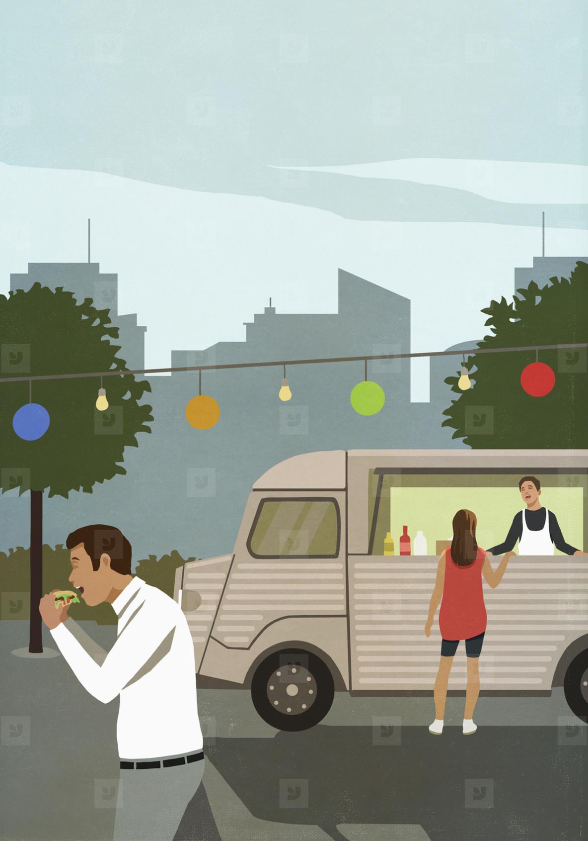 Woman ordering food at urban food cart