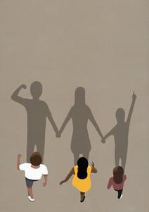 Large shadows of family walking