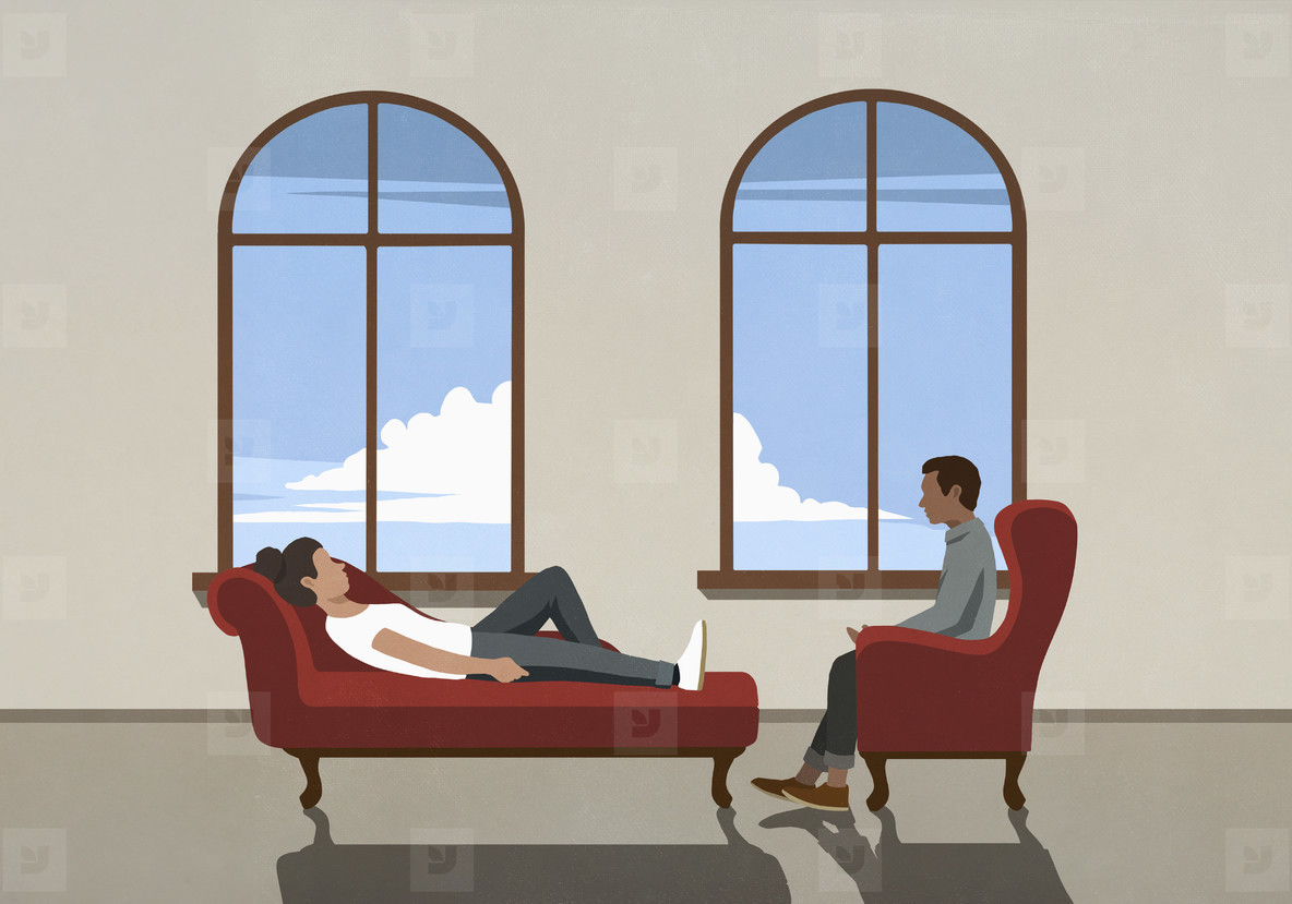Therapist talking to patient on chaise longue in office