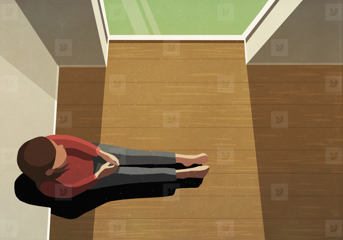 Lonely woman sitting in sunny window