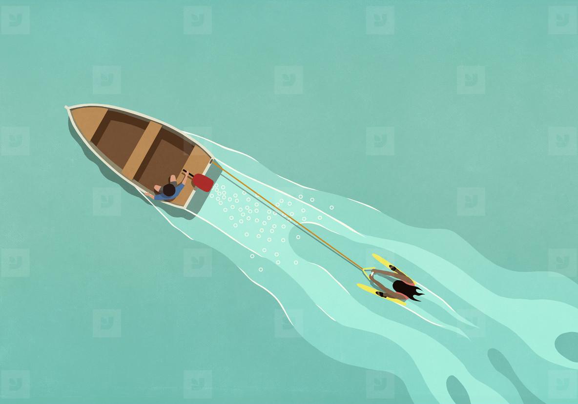 Rowboat pulling water skier