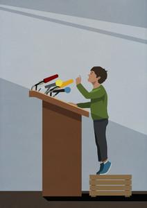 Boy on crate talking at podium