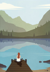 Serene woman sitting on dock at tranquil summer lake