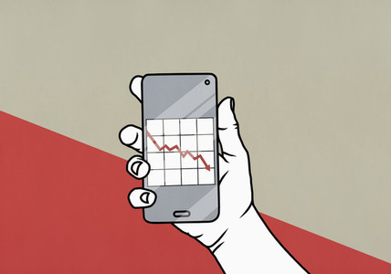POV Hand holding smart phone with downward graph on screen