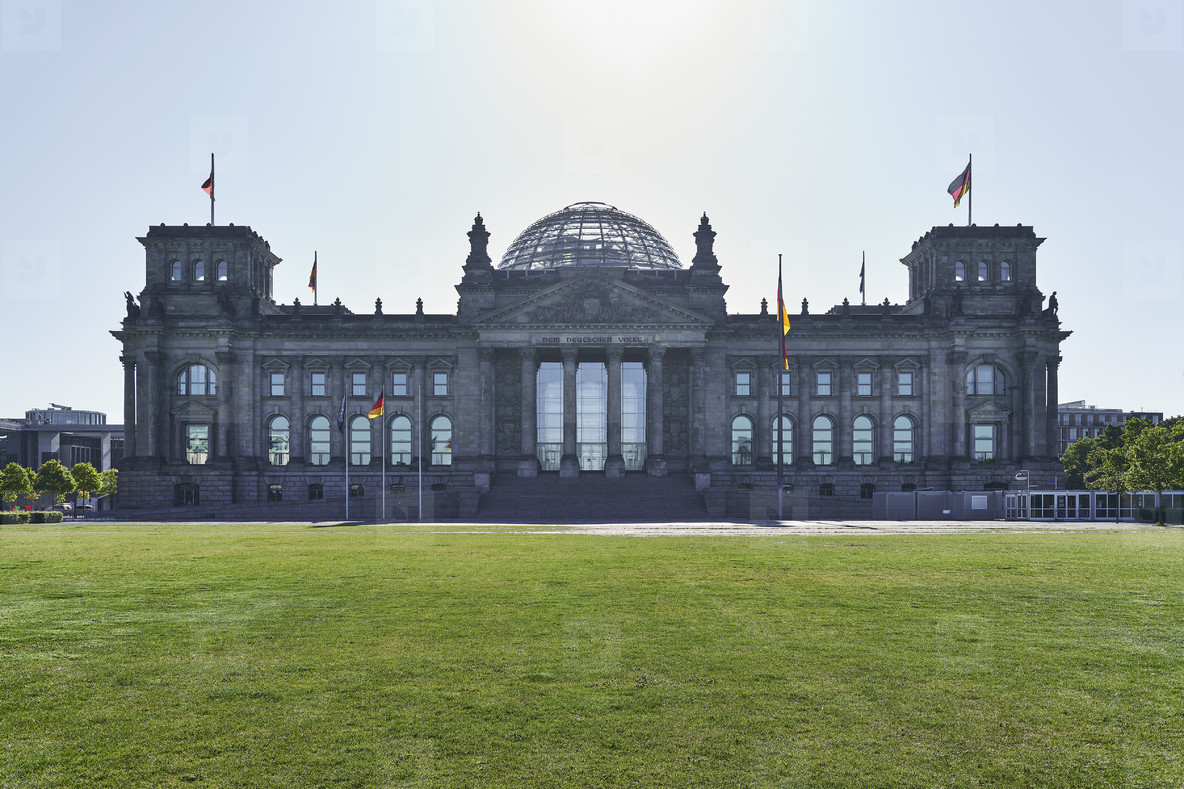 Reichstag building and German flags Berlin Germany