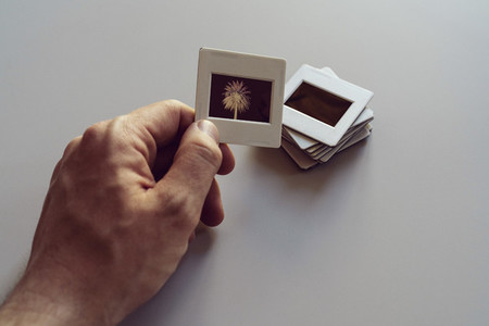 Hand holding photographic slides