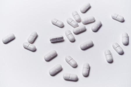Prescription pills on white background
