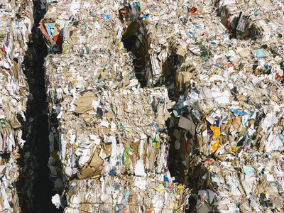 Recycled paper bundles at sunny recycling center