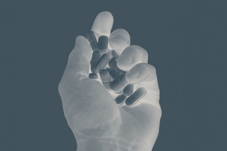X ray shot hand holding prescription pills