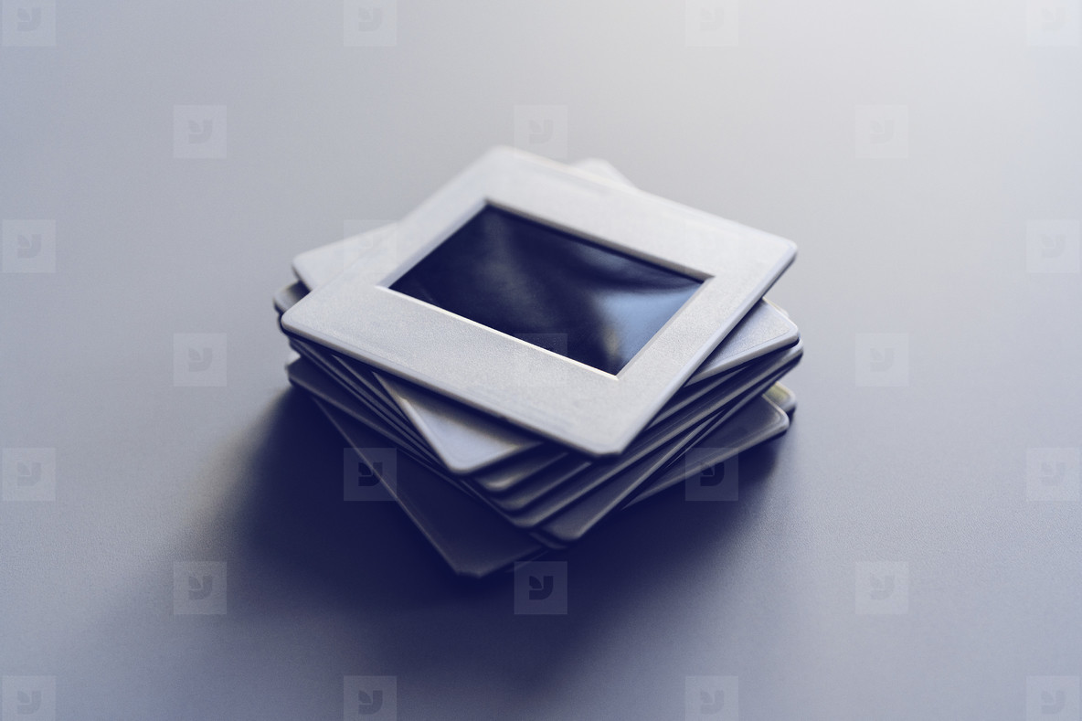 Photographic slides stacked on white background