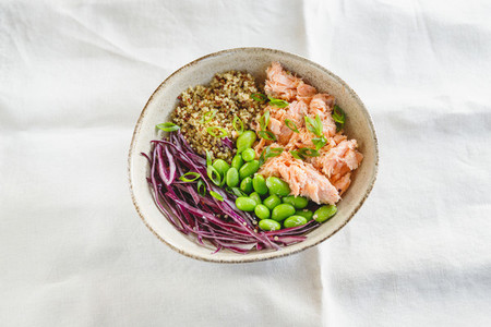 Poke bowl with couscous  baked salmon  bean  and cabbage  Healthy eating concept