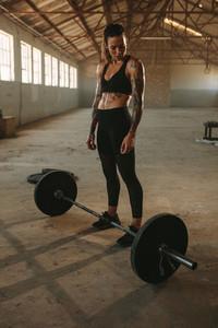 Muscular female athlete at cross training gym