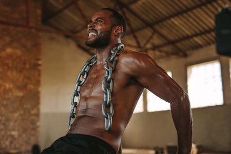Tough man doing triceps dips exercise