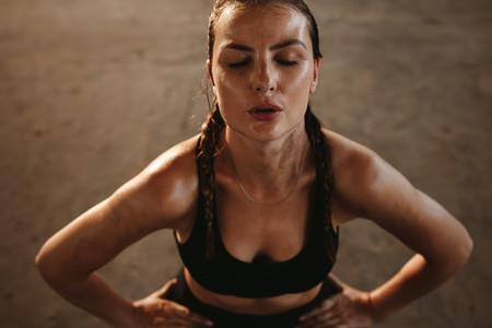 Woman taking break after intense workout