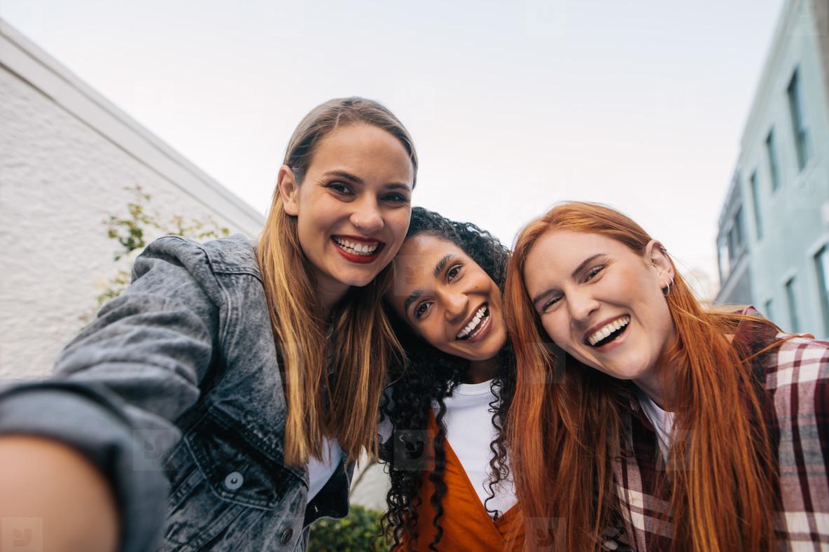 Group of women in the city taking selfie