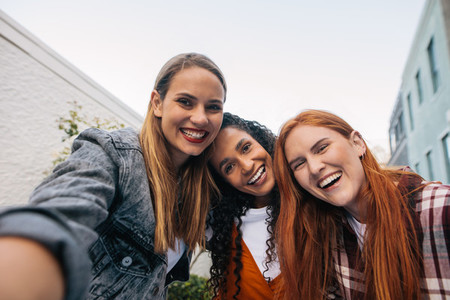 Group of women in the city taking selfie