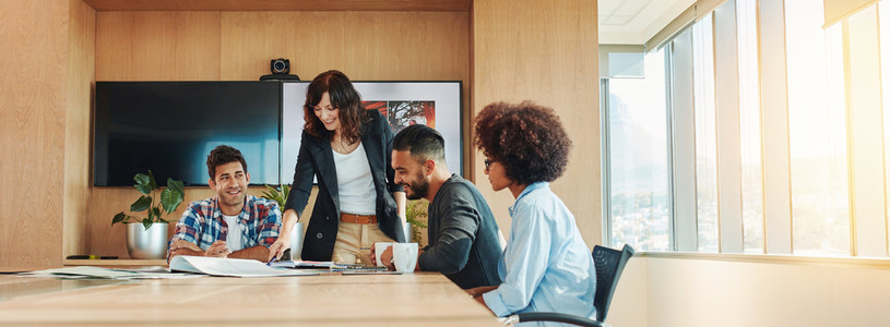 Multi ethnic business people meeting in conference room