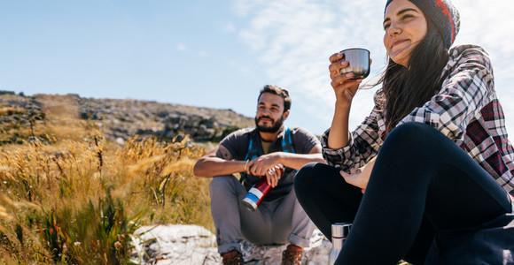 Friends taking break during hike
