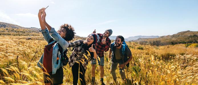 Friends taking selfie on hiking trip