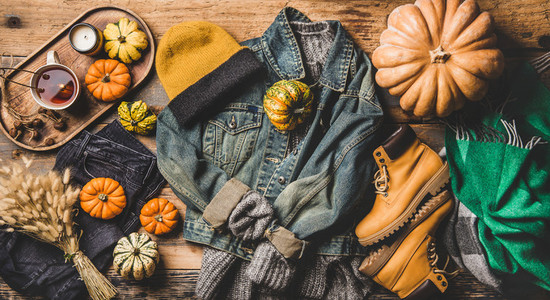 Autumn trendy women outfit layout over wooden background