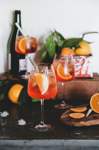 Aperol Spritz cocktail in glasses with oranges and ice