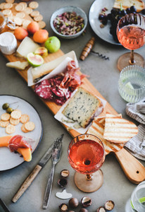 Mid summer picnic with rose wine  cheese  charcuterie  appetizers and fruits