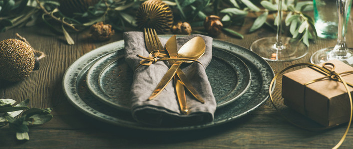 Christmas or New Years celebration table setting wide composition