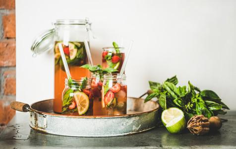 Fresh strawberry and basil lemonade in glass jars copy space